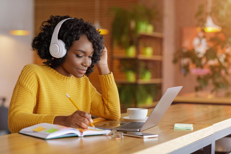smiling black girl with headset studying online us ZB9E52C